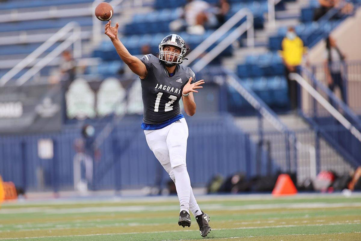 Desert Pines' Rjay Tagataese (12) throws a pass in the second quarter of a football game agains ...