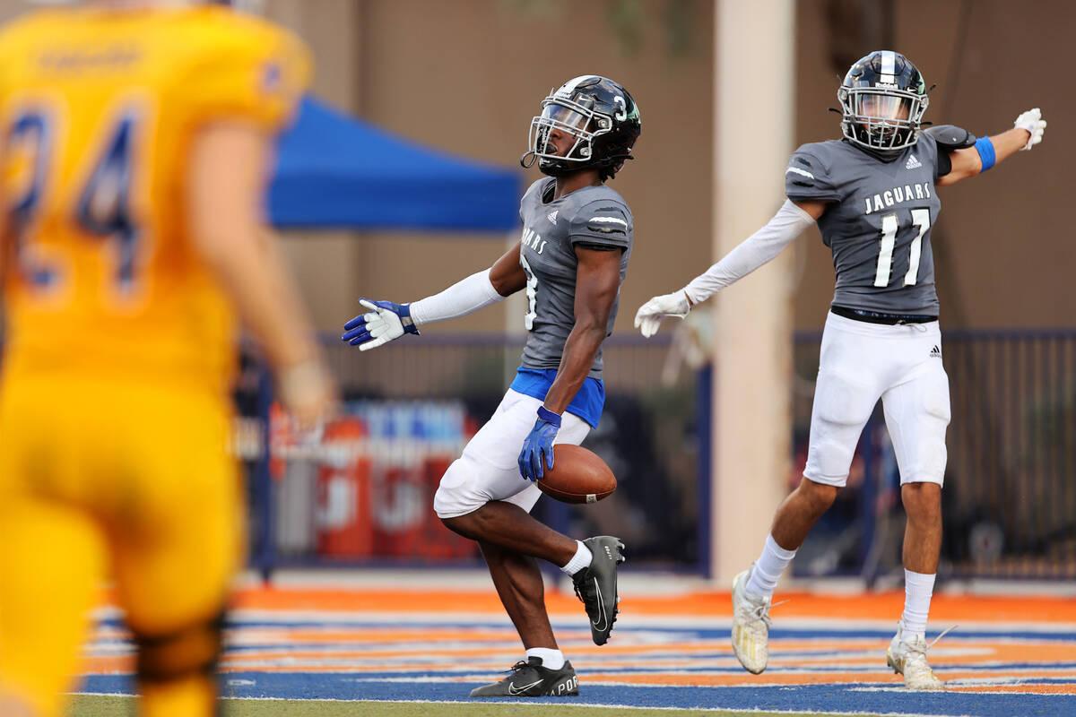 Desert Pines' Izley Manutai (13) celebrates a touchdown catch with Josiah Barron (17) in the fo ...