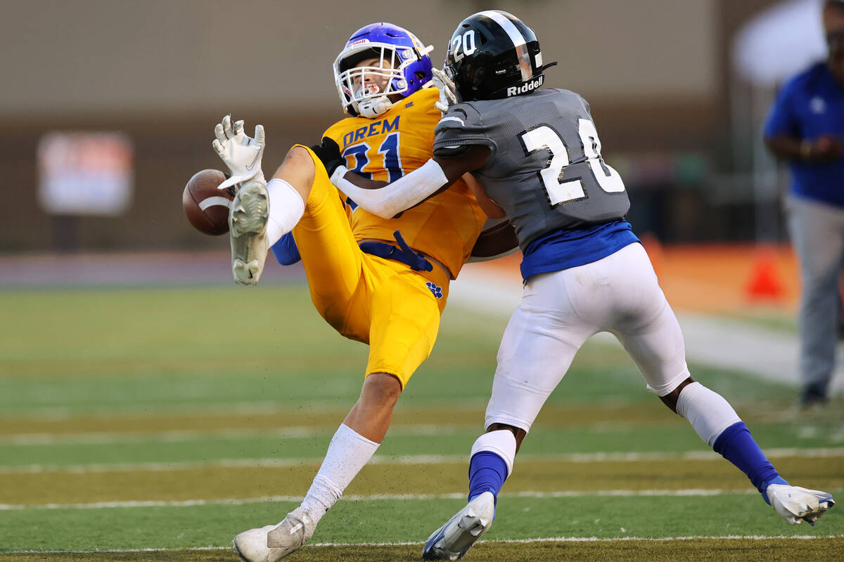 Desert Pines' Isaiah Rubin (20) tackles Orem's Asher Young (81) in the fourth quarter of a foot ...