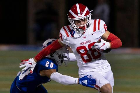 Liberty High safety Saco Alofipo (20) tries to take down Mater Dei High wide receiver Jack Ress ...