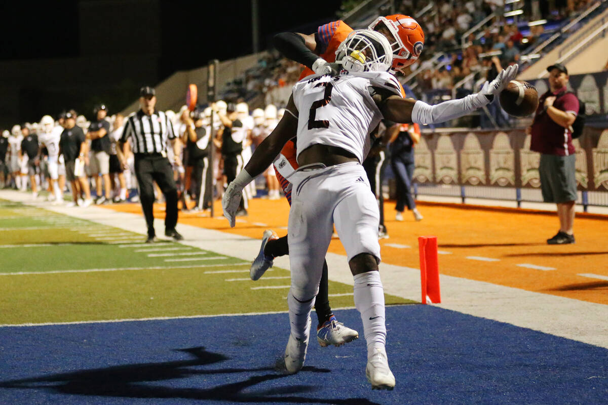 Bishop Gorman's Fabian Ross (4) interferes with a pass intended for Lone Peak's Luke Hyde (2) i ...