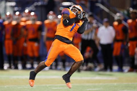 Bishop Gorman's Zachariah Branch (1) runs the ball for a touchdown after a catch in the fourth ...