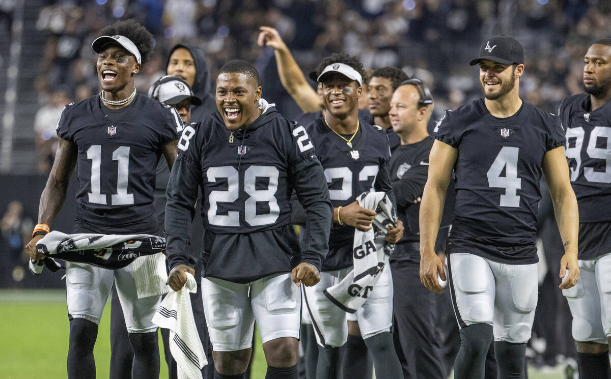 (From left) Raiders wide receiver Henry Ruggs III (11), running back Josh Jacobs (28), running ...