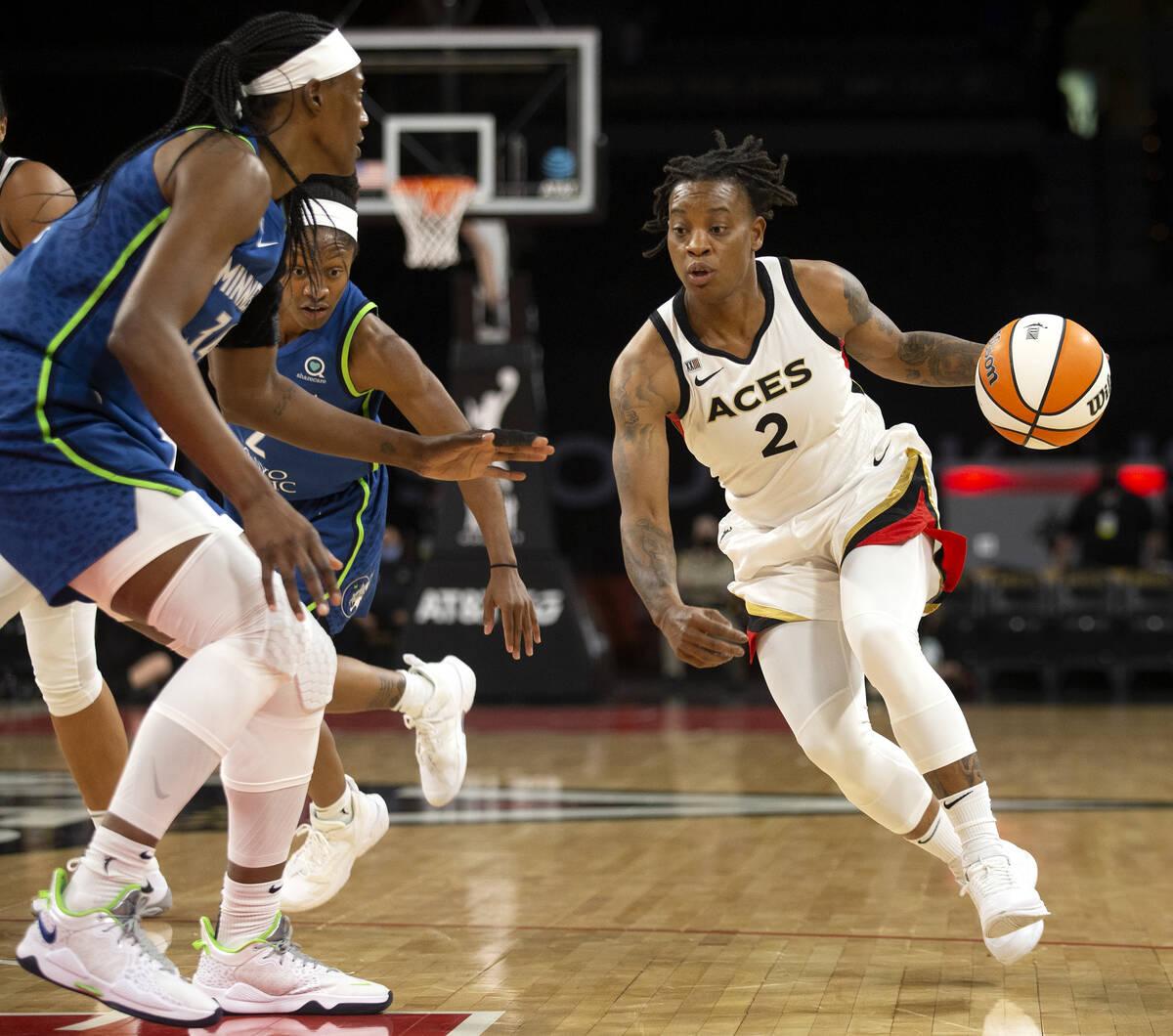 Las Vegas Aces guard Riquna Williams (2) dribbles around Minnesota Lynx center Sylvia Fowles (3 ...