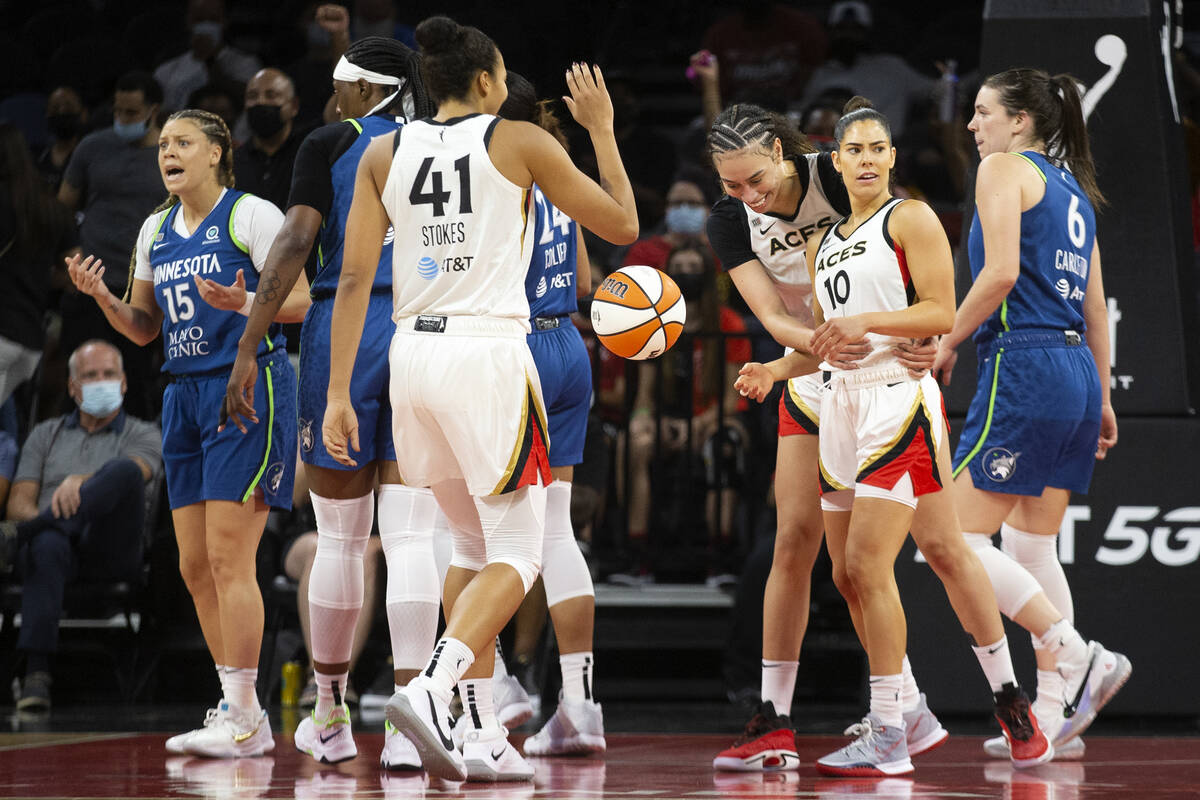 Las Vegas Aces forward Dearica Hamby (5) and guard Kelsey Plum (10) after Plum was fouled by Mi ...