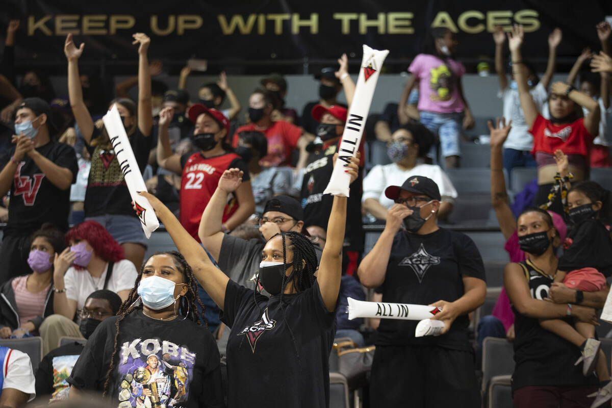 Las Vegas Aces fans cheer for their team during the second half of a WNBA game against the Minn ...