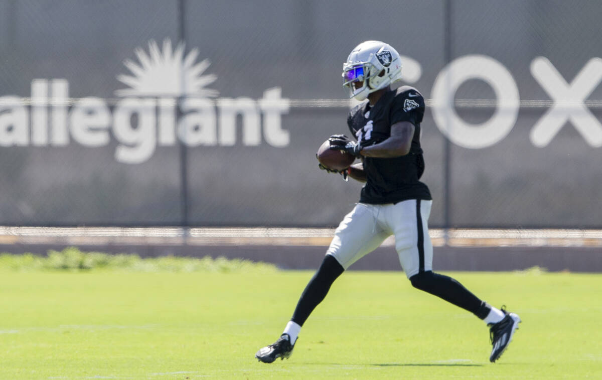 Raiders wide receiver Henry Ruggs III (11) makes a catch during team practice at the Raiders He ...