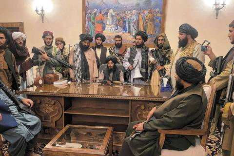 Taliban fighters take control of Afghan presidential palace after the Afghan President Ashraf G ...