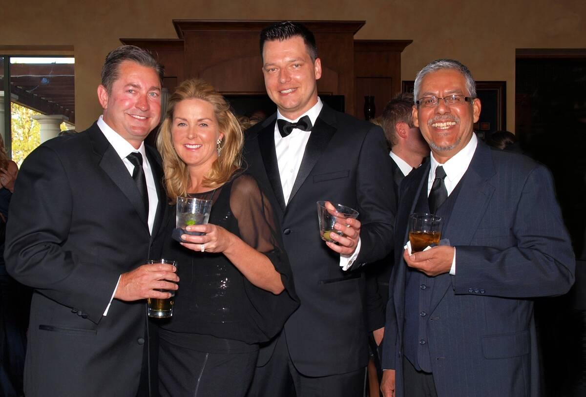 From left, Scott and Jill Gragson, Robert Torres Jr., and Robert Torres Sr. (Las Vegas Review-J ...