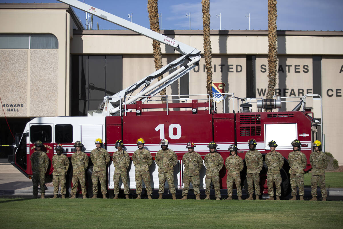 Firefighters stand at attention during the Nellis Fire and Emergency Services 9/11 Memorial at ...