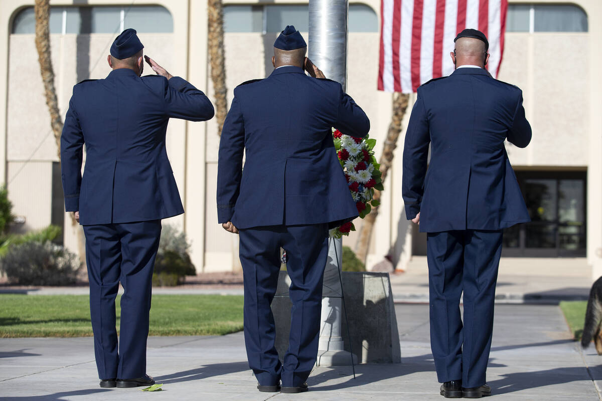 Nellis Air Force Base leadership salute at a wreath-hanging ceremony during the Nellis Fire and ...
