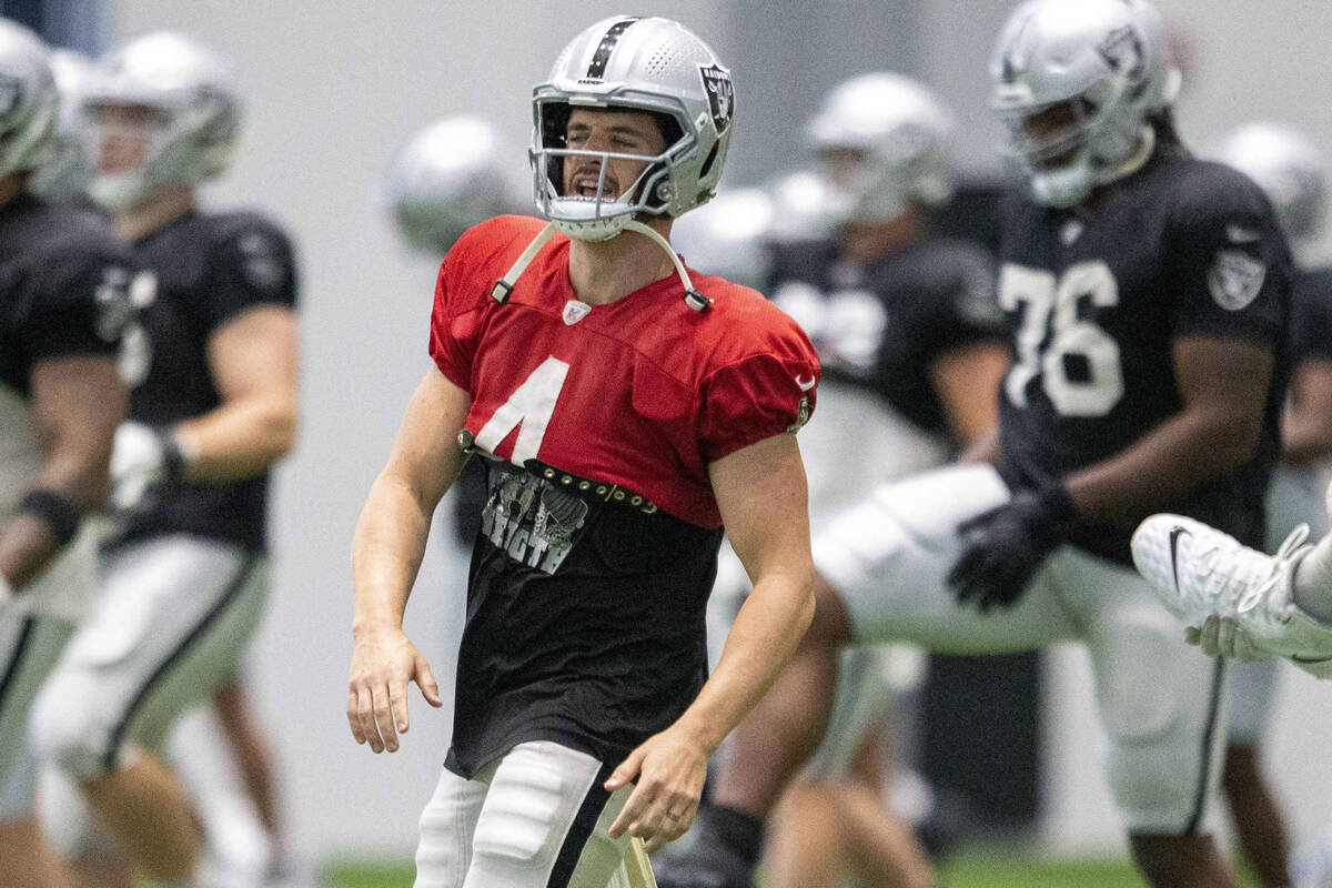 Raiders quarterback Derek Carr (4) sings as he stretches during team practice at the Raiders He ...