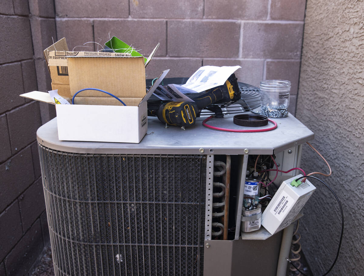 An air conditioner is under repair at Vulcan St on Friday, Sept. 10, 2021, in Henderson. (Bizua ...