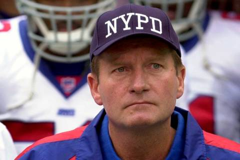 In this Sept. 23, 2001, file photo, New York Giants coach Jim Fassel wears a New York Police D ...