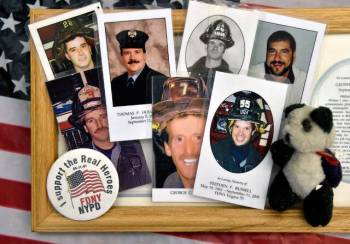 Commemorative cards for the mass with photographs of fallen firefighters, collected from the city of New York-New York ...