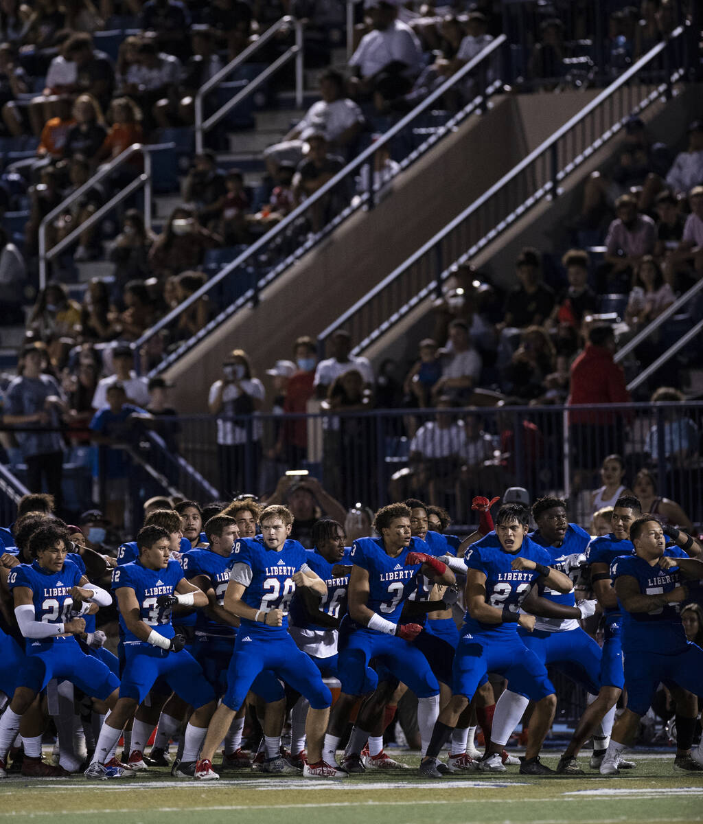 Liberty HighÕs players perform their ritual before facing Mater Dei High of Calif., during ...