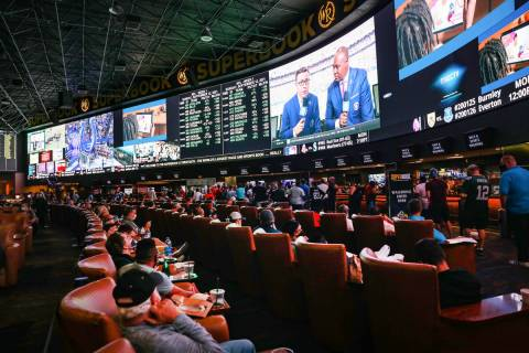 A packed house watches the screens at the Sports Book at Westgate in Las Vegas, Sunday, Sept. 1 ...