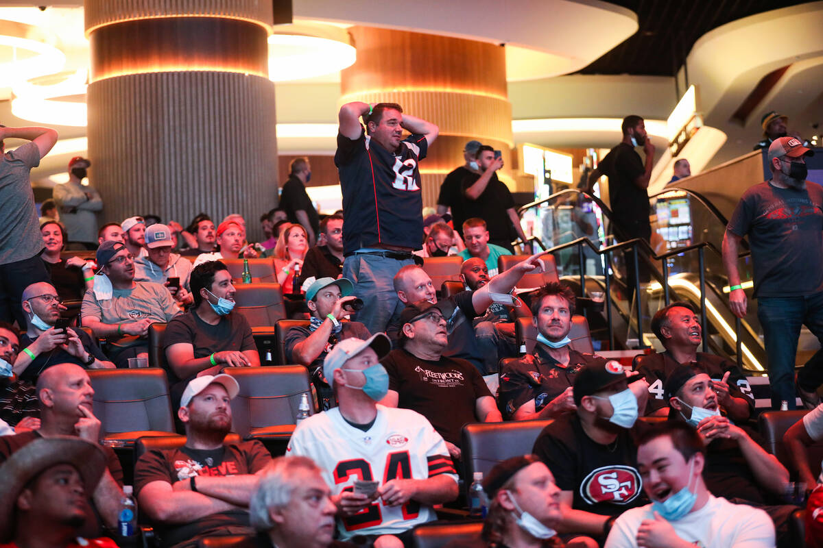 Guests watch the screens for the first week of the NFL season at the Sportsbook at Circa in Las ...