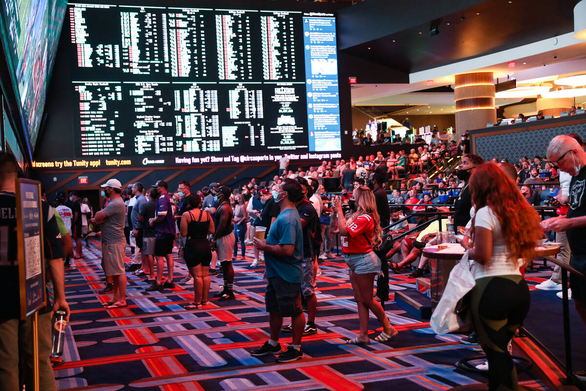Guests watch the game as they wait to place their bets at the Sportsbook at Circa in Las Vegas, ...