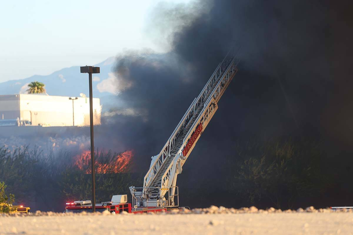 The North Las Vegas Fire Department battles a fire at a Republic Services recycling facility on ...