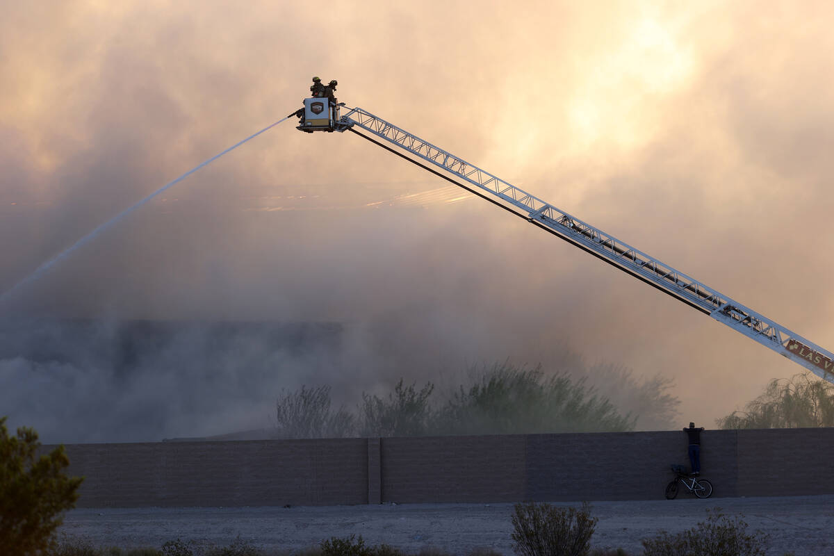 The North Las Vegas Fire Department battles a fire at a Republic Services recycling facility Mo ...