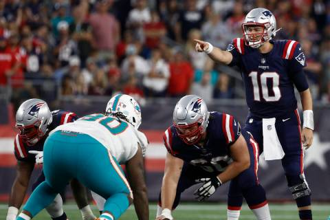 New England Patriots quarterback Mac Jones (10) during the second half of an NFL football game, ...
