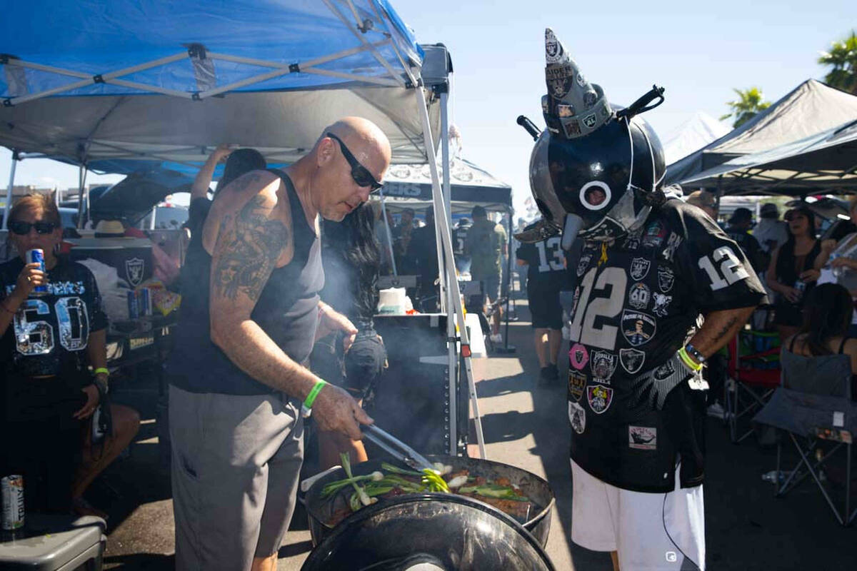 Joe Gomez and Raider Jack tailgate before an NFL football game between the Raiders and Baltimor ...