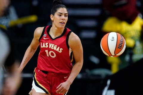 Las Vegas Aces' Kelsey Plum in action against the Seattle Storm during WNBA basketball game Sat ...