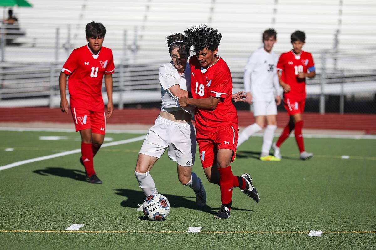 Westernճ Joshua Rodriguez (19) steals the ball from Shadow Ridgeճ midfielder Joaqui ...