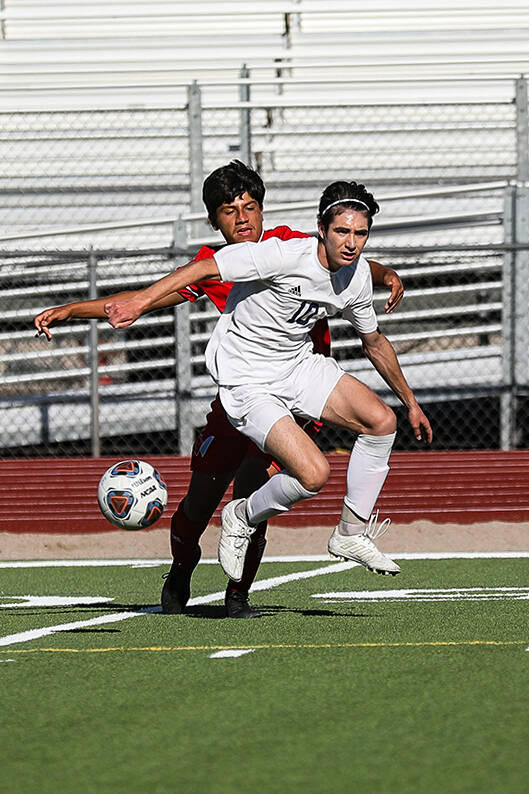 Shadow Ridgeճ midfielder Joaquin Gomez (10) blocks the ball from Westernճ Elijah Es ...