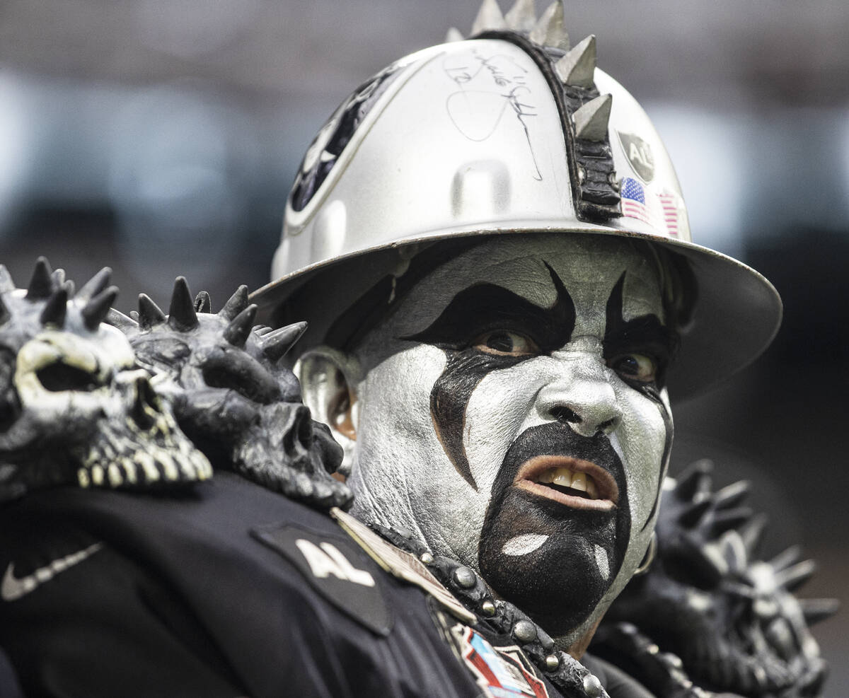 Raiders fans cheer for Las Vegas during an NFL football game against the Baltimore Ravens at Al ...