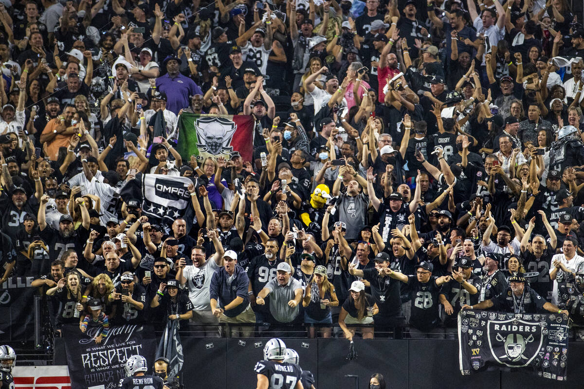 Raiders fans celebrate another score over the Baltimore Ravens during the fourth quarter of the ...