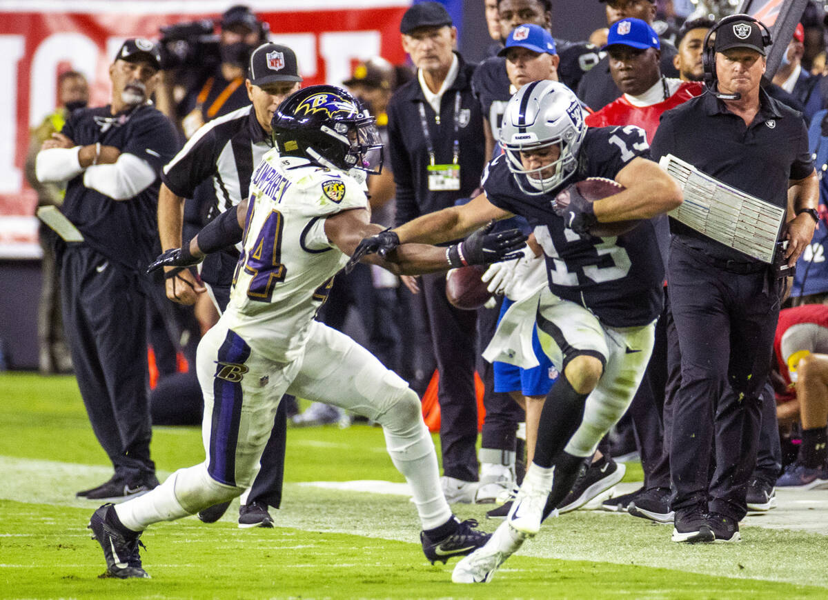 Raiders wide receiver Hunter Renfrow (13) escapes down the sidelines as Baltimore Ravens corner ...