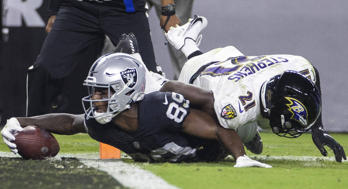 Raiders wide receiver Bryan Edwards (89) extends to try to score a touchdown against Baltimore ...