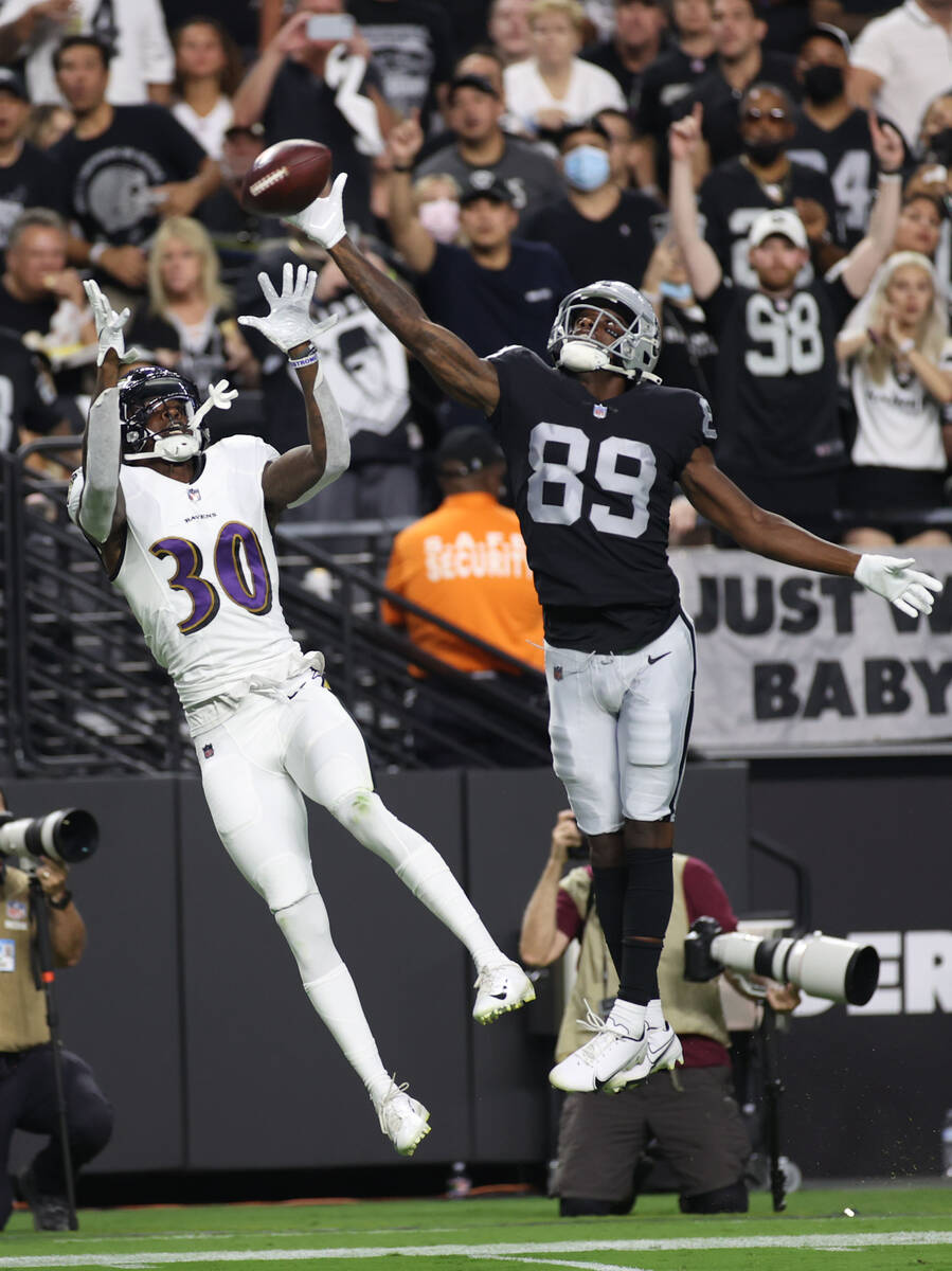 Raiders wide receiver Bryan Edwards (89) tires to catch a ball against Baltimore Ravens cornerb ...