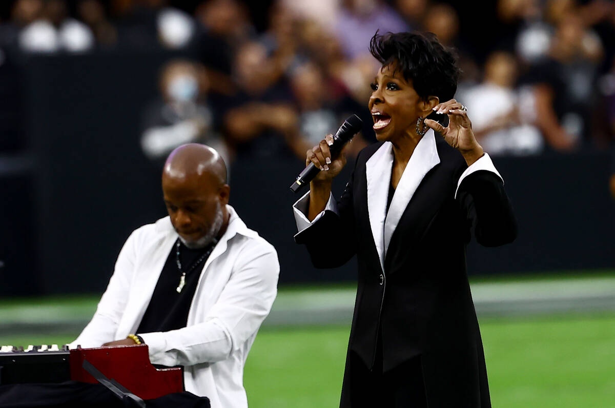 Gladys Knight sings the national anthem before an NFL football game between the Raiders and the ...