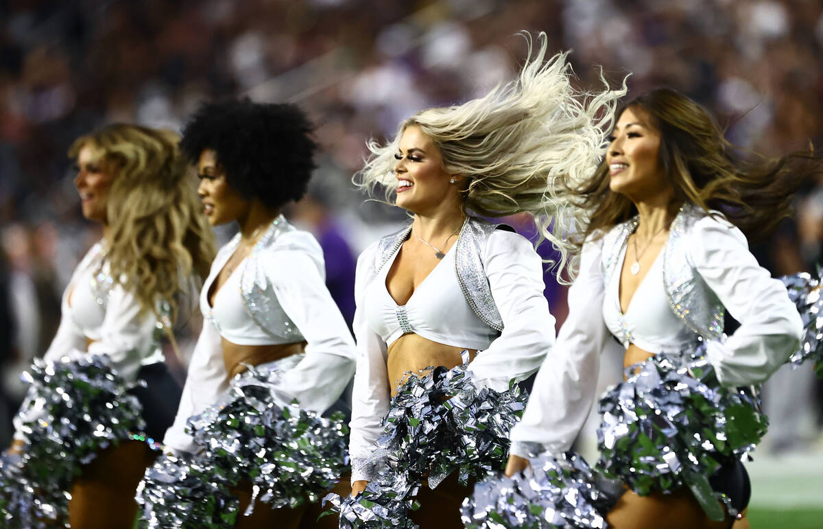 Raiders cheerleaders perform during the second quarter of an NFL football game at Allegiant Sta ...