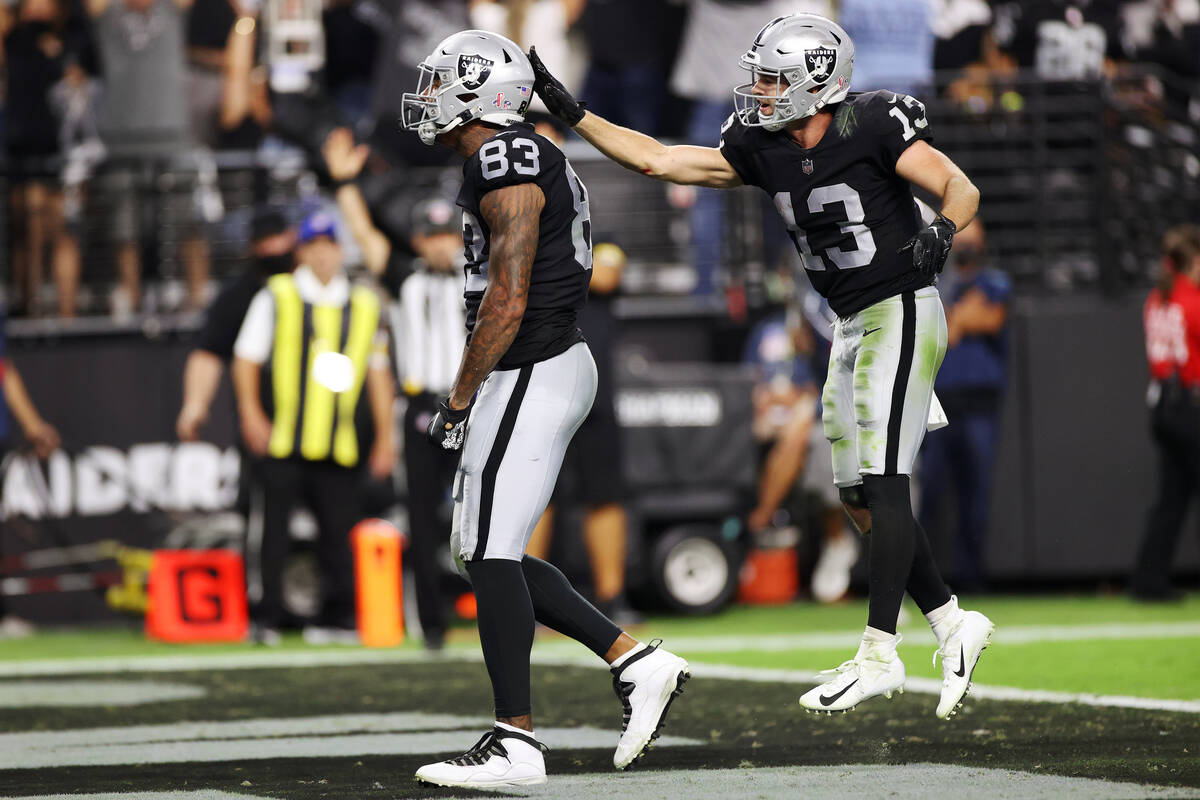 Raiders tight end Darren Waller (83) celebrates his touchdown with wide receiver Hunter Renfrow ...