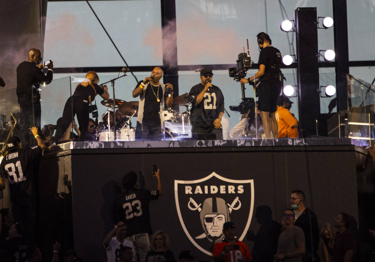 Too Short, center left, and Ice Cube perform during halftime at an NFL game between the Raiders ...