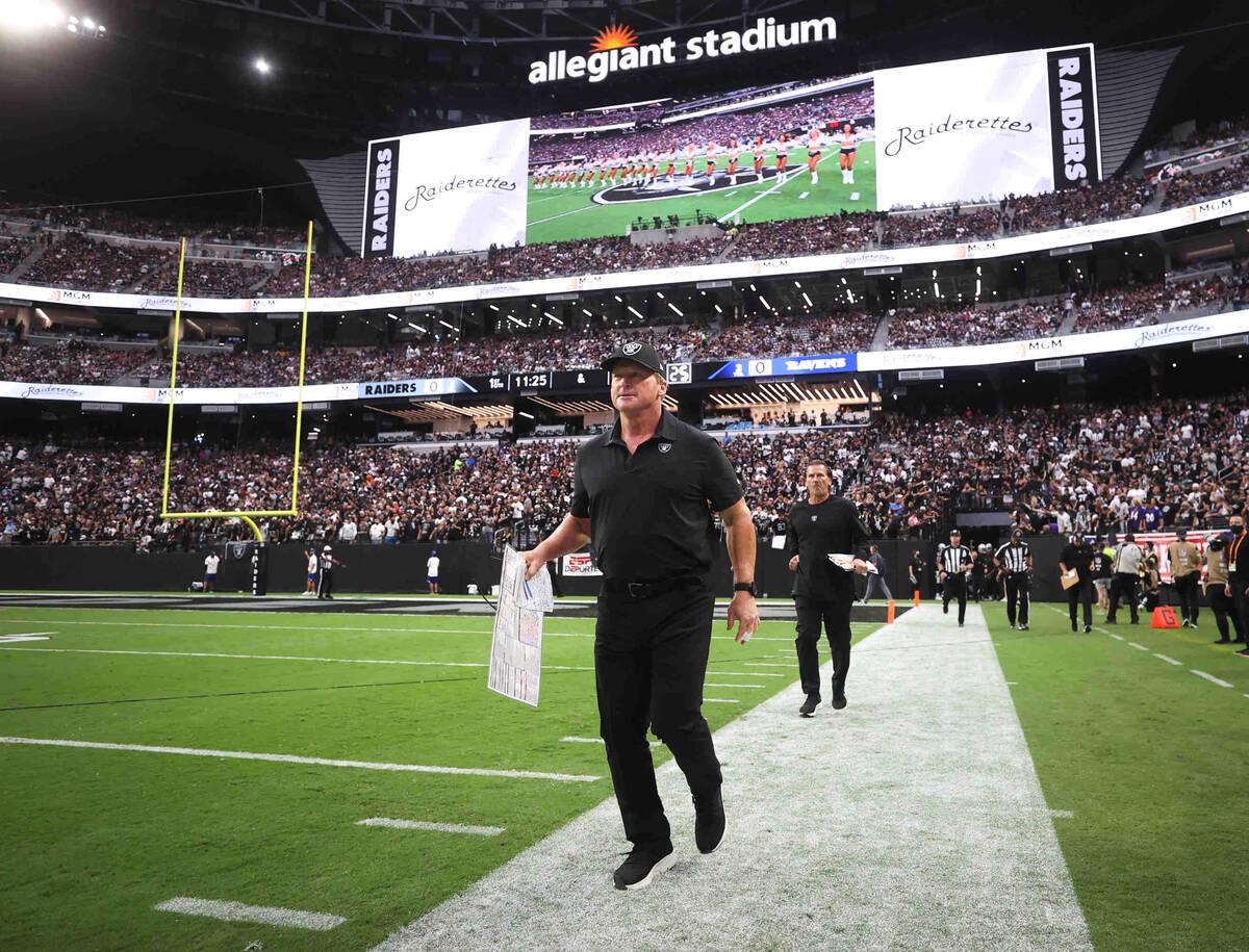 Raiders head coach Jon Gruden takes the field before an NFL football game between the Raiders a ...