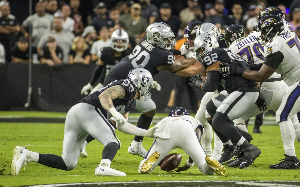 Baltimore Ravens quarterback Lamar Jackson (8) drops the ball during the second quarter of the ...