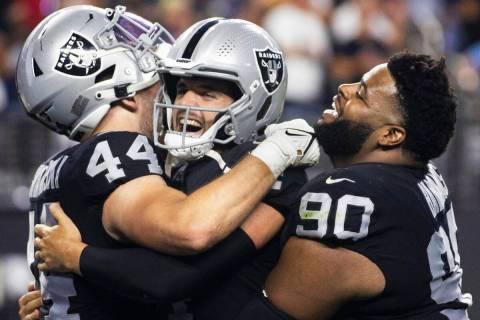 Raiders quarterback Derek Carr (4) celebrates a big play with Raiders inside linebacker Nick Kw ...
