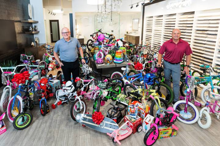 Chet Buchanan, left, 98.5 KLUC DJ whose annual Toy Drive to benefit HELP of Southern Nevada is ...