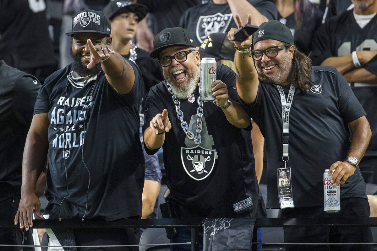 Raiders fans cheer during the first quarter of an NFL football game against the Baltimore Raven ...