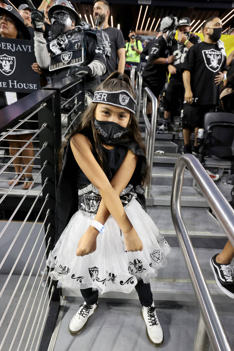 Fans, including Jocelyn Lopeman, 6, of Fontana, Calif. cheer as the Raiders take on the Baltimo ...