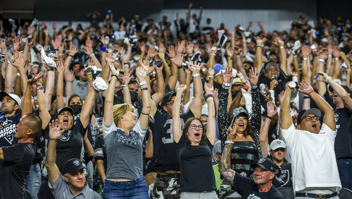 Raiders fans get excited during the fourth quarter of the Raiders' season-opener against the Ba ...