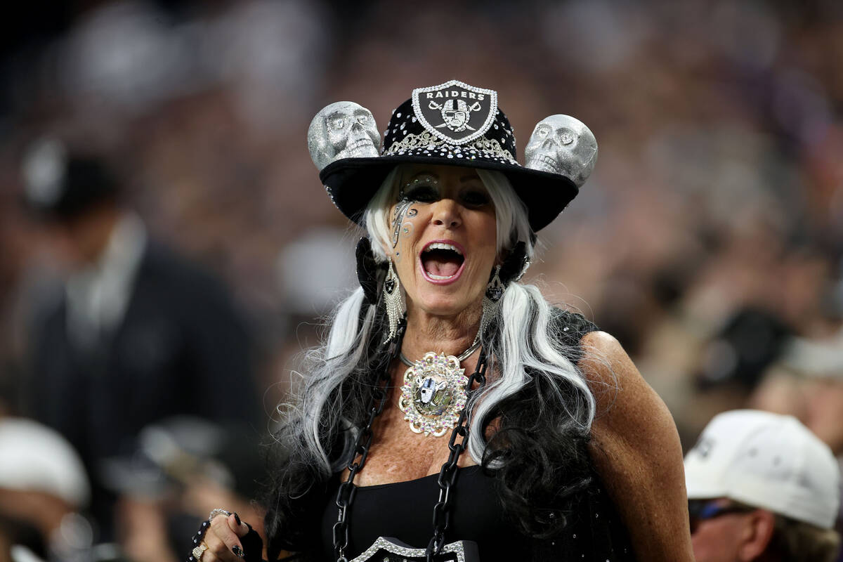 A Raiders fan cheers during the first quarter of an NFL football game at Allegiant Stadium, Mon ...