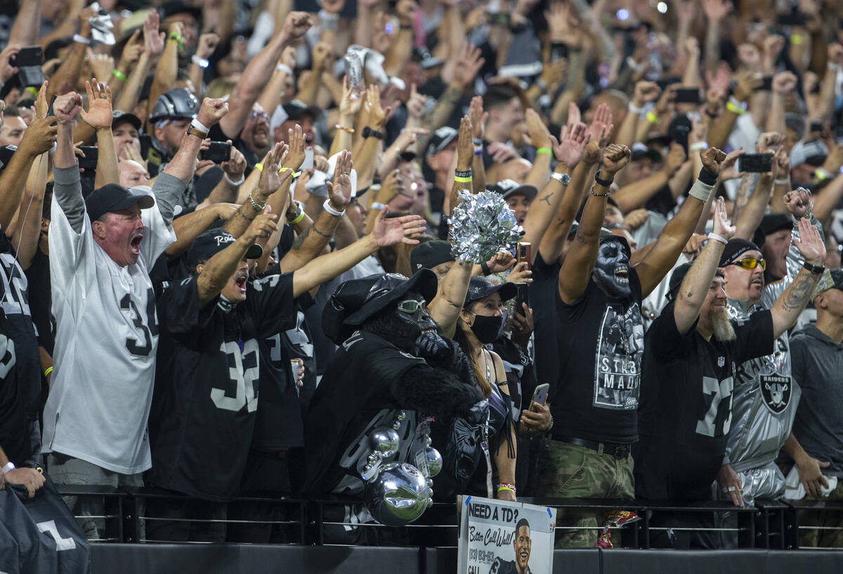 Raiders fans react after Josh Jacobs scores the Raiders' first touchdown of the game dur ...