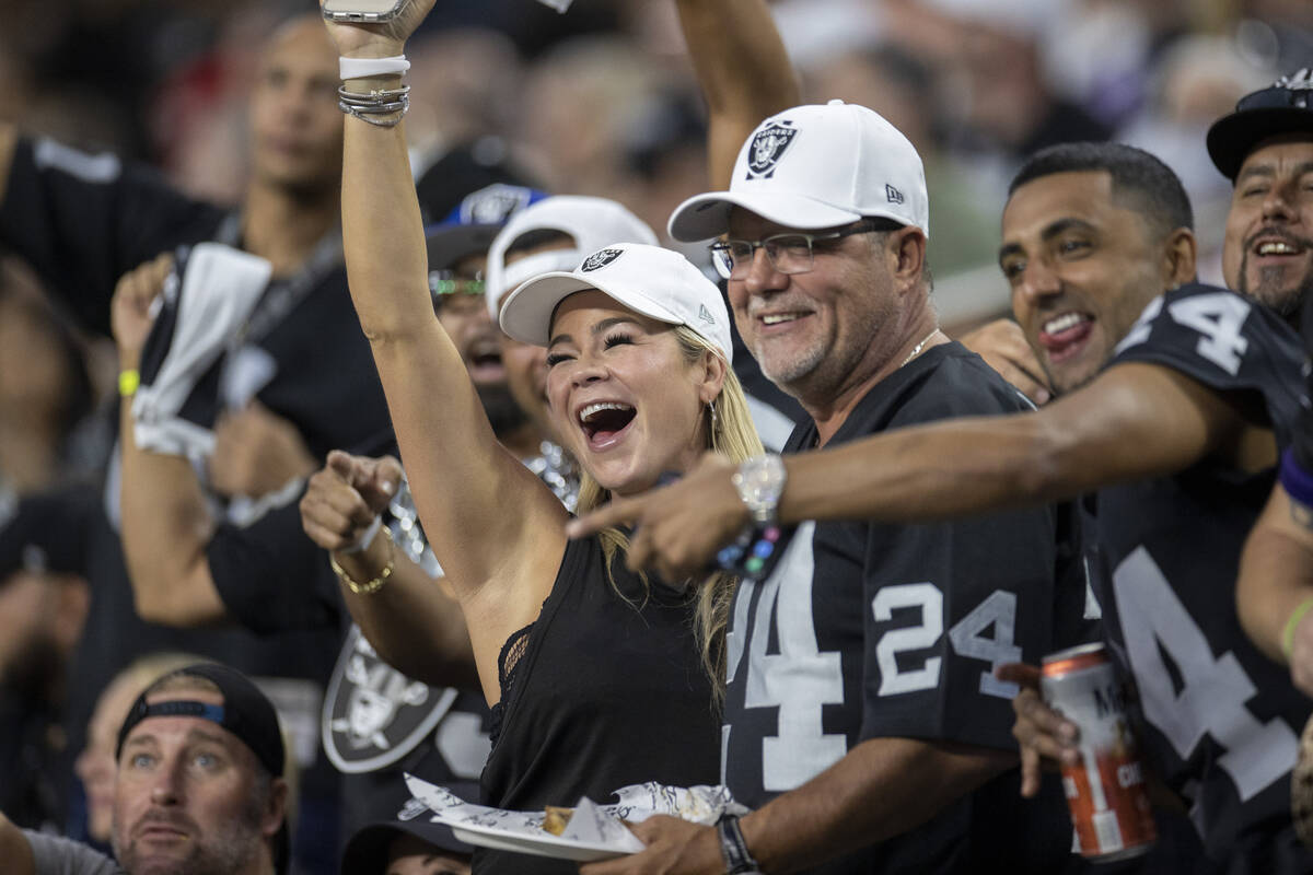 Raiders fans cheer during an NFL football game between the Raiders and Baltimore Ravens at Alle ...
