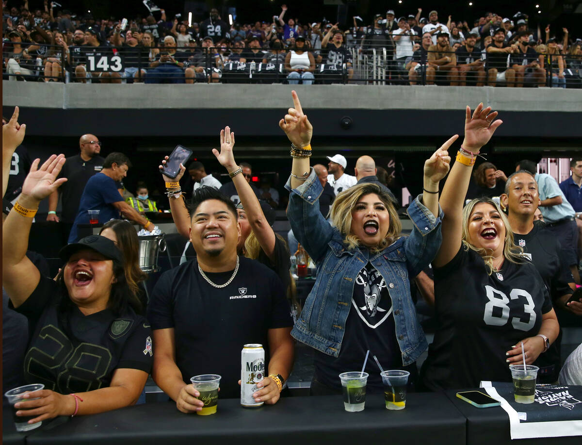 Raiders fans cheers before an NFL football game against the Baltimore Ravens at Allegiant Stadi ...